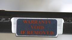 Warranty void if removed (Pascal Volk) Tags: hdd harddiskdrive festplatte sticker label macro makro 210mm closeup nahaufnahme macrodreams bokeh dof depthoffield canoneos6d sigma105mmf28exdgoshsmmacro sigmaapoteleconverter2xexdg