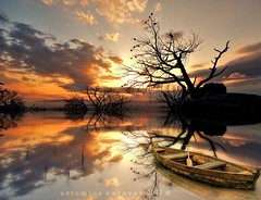 reflections in the fantasy land (artemioskaravas) Tags: reflections greece athens water trees boat lake clouds color sunset shadow sky sunny sea