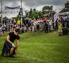 Kiltie Kneeling (FotoFling Scotland) Tags: kilt fife cereshighlandgames
