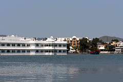 Cartoon - Taj Lake Palace hotel and Leela Palace on shore of Lake Pichola (Ashish A) Tags: windows sky india building window water canon buildings hotel boat asia action cartoon bluewater bluesky hotels dslr canondslr digitalslr heritagebuilding rajasthan udaipur whitebuilding lakepalacehotel canoncamera lakepichola heritagehotel luxuryhotel leelapalacehotel canoneos50d tajlakepalacehotel heritagestructure colorfulboat heritagemonument hotelinlake