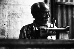 (Julie Stutzman) Tags: street camera travel india white man black film analog 35mm photography asia day sewing working machine craftsman tailor rajasthan jodhpur