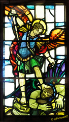 Good Versus Evil (Steve Taylor (Photography) Internet V slow) Tags: church window saint angel wings good evil halo stainedglass virtue stmartin christian sabre barefoot sword demon devil vs beaten imp fiend daemon versus overcome leadlight stmartinoftours leadlighting uncleanspirit