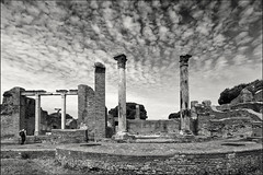 ostia antica (heavenuphere) Tags: old city bw italy man rome roma building history archaeology monument architecture outdoors temple site ancient europe italia roman antica column 1022mm ostia archeological ruined ostiaantica ancientrome traveldestinations placeofinterest oldruin builtstructure