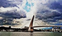 P1170852c (hooi_lee) Tags: bridge sea cloud landscape taiwan dramatic panasonic tanshui lx5