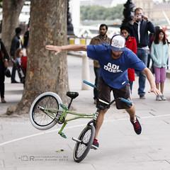 Balance (R.Azhari) Tags: show street uk london bike bicycle sport canon raw performance southbank balance embankment acrobatic canon50mm eos500d t1i