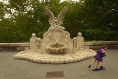 Hamilton Fountain: one of the last remaining horse troughs in New York City (Ed Yourdon) Tags: newyork fountain alone manhattan skating scooter upperwestside littlegirl solitary riversidepark trough streetsofnewyork horsefountain everyblock hamiltonfountain robertrayhamilton