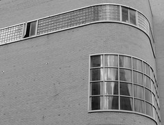 (tarabunnyears) Tags: old windows building glass architecture curves wv westvirginia oldbuilding charlestonwv stoneandthomas