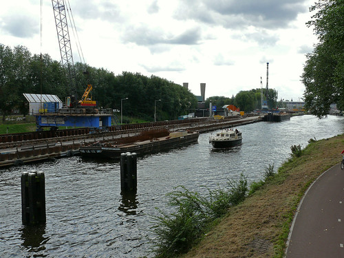 A view over the last part of the canal Noord-Hollands kanaal and the construction site of the new metro-tunnel - caps of Central Station Amsterdam at the horizon; urban photography in the Netherlands, Fons Heijnsbroek, 2007
