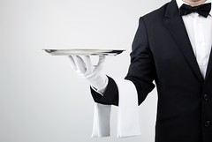 Waiter holding empty silver tray over gray background (partyshoplufra) Tags: food white holiday man male portugal metal dinner yard work silver person restaurant hotel marketing king hand message arm steel space empty rich gray formal royal first style plate class business suit staff butler present glove tray customer service presentation concept elegant job copy luxury isolated hold waiter servant serve wellness