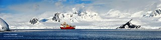 Panoramic image of HMS Protector, in the vast and beautiful landscape of Antarctica.