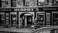 The Finger (Garr8) Tags: street ireland blackandwhite bw irish man building 35mm mono march pub day fuji finger candid traditional thefinger streetphotography rude evil parade celebrations elderly friendly northernireland 17 fujifilm welcome marketstreet stpatrick gesture smoker murphys fujinon disgruntled marketst punter countydown oldgeezer paddys pensioner paddysday saintpatrick march17 xseries murphyspub downpatrick oldcodger northdown milc murphysbar johngarrett bt30 xpro1 garr8 compactsystemcamera electronicviewfinderinterchangeablelens fujixpro1 xf35mm xf35mmf14r zoomwithyourfeet 78marketst bt306lz evilshooter creativeevilphotography mirrolessinterchangeablelenscamera