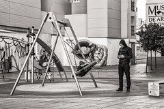 let the children play (Gerard Koopen) Tags: spanje spain malaga city bw blackandwhite straat street straatfotografie streetphotography children playing man mobile fujifilm fuji xpro2 56mm 2017 gerardkoopen