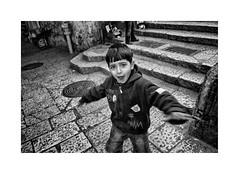 The cheeky boy (Jan Dobrovsky) Tags: city contrast document grain israel jerusalem middleeast monochrome muslimquarter nikond80 oldtown people stone street texture blackandwhite