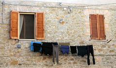 Te lo tengo para mañana (Lady Smirnoff) Tags: laundry lavanderia ropa clothes hanging ventanas windows outdoor exterior fotocuento