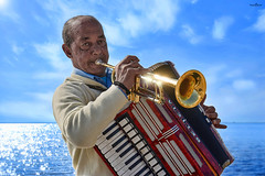 the cuban (dim.pagiantzas   photography) Tags: cuban gypsy man people male music musician accordion trumpet musical instruments sound sea seascape water waterscape sky clouds reflections light golden colors colorfull outdoor portrait environment