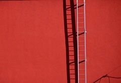 Ladders on the wall (mcfcrandall) Tags: red wall ladder shadow light plovdiv bulgaria sun outdoors