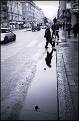 132 AF35MII TriX400 32 (rubbernglue) Tags: compactcamera canon af35m flemminggatan stockholm sverige sweden bw blackandwhite bwfp filmphotography filmexif streetphotography reflection water rainyday tanol allmycamerasproject