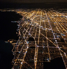 Over Chicago (` Toshio ') Tags: toshio chicago ord illinois city greatlakes lakemichigan night fliying united flight patterns lights iphone