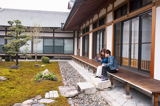 Young couple taking picture of Japanese moss garden