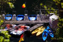 Behind The Trees. (Tzatzinki) Tags: boats boote tretboot heimbach eifel idyll stausee