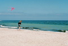 Girl and kite at the seaside (alexeieviciu) Tags: kite film seaside nikon superia 400 60