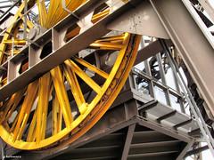 Inside the Eiffel Tower (gabi-h) Tags: paris france yellow reflections wheels elevator eiffeltower gabih
