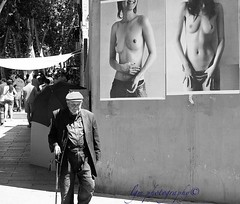 Oblivious (Halcon122) Tags: madrid street bw walking spain downtown raw alone afternoon candid streetphotography stranger elderly cleavage rastro