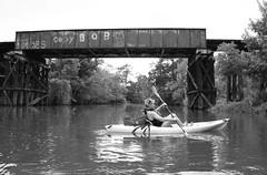 Kayak & Pony Girder Railroad Bridge over Cedar Bayou, Baytown, Texas 1309281503BW (Patrick Feller) Tags: county railroad trestle bridge train rust kayak texas crossing baytown steel rr bayou pony cedar kayaking harris chambers girder riveted pontist