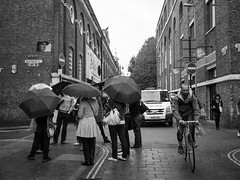 POLICE Pursuit (-Dons) Tags: street england man london bicycle umbrella police
