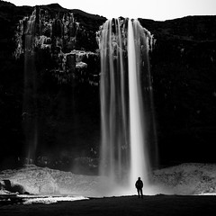 Frozen Angelhair (Mabry Campbell) Tags: blackandwhite bw cliff man ice water monochrome silhouette person photography photo waterfall iceland europe photographer image fav50 south fav20 cliffs photograph april scandinavia fav30 squarecrop seljalandsfoss lansdscape fineartphotography architecturalphotography commercialphotography fav10 southiceland fav100 fav200 2013 fav40 fav60 architecturephotography fav90 fav80 southerniceland fav70 houstonphotographer dineart eos5dmarkiii mabrycampbell