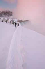 Niagara Falls: Railing at dawn (Shahid Durrani) Tags: winter snow waterfall niagara falls {vision}:{outdoor}=0843 {vision}:{text}=0516 {vision}:{sky}=0804 {vision}:{sunset}=06
