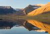 Mighty Westfjords (Dani℮l) Tags: ocean blue light sea sun mountain snow reflection ice water yellow rock sunrise landscape iceland farm daniel slope westfjords bosma ijsland flateyri