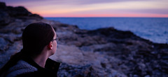 Serenity (matej.duzel) Tags: people woman beach winter croatia istria pula adriatic sea verudela sunset leica gh3 25mm natural light color dusk distance bokeh rocks cold blue water sky clouds