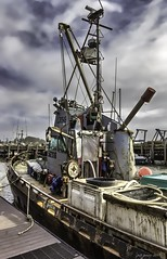 Work Boat. Moro Bay, CA (jeffjones) Tags: boats clouds phototype seascape