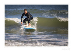 Riding The Wave (Seven_Wishes) Tags: newcastleupontynenortheast kc canoneos1dmarkiv canonef100400mmf4556lisii photoborder outdoor tynemouth longsands beach people candid coast sea coastal surfer surfboard wetsuit wave water
