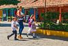 Mom and Her Kids (fotofrysk) Tags: schoolsout children schoolchildren backpacks wheelers whitedress whiteshirt schooluniform parent pickupcentralamericatrip nicaragua granada sigma1750mmf28exdcoxhsm nikond7100 201702069488201702069456