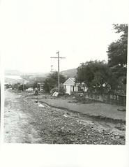 Storm damage in Stokes Valley, December 1976. (Archives New Zealand) Tags: archives archivesnewzealand archivesnz nationalpublicitystudios newzealand newzealandhistory nz northisland storm naturaldisasters disaster weather rainfall lowerhutt stokesvalley 1976