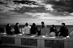 Brighton Promenade (I M Roberts) Tags: brighton promenade groupofpeople dramaticlight seafront eastsussex bw fujix100s