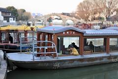 IMG_0717 (Geology Joel) Tags: boatman boats bridge changman china citylife oldtown people river tea warf drinking breaktime smoking