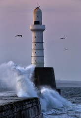 I Stand Alone (PeskyMesky) Tags: aberdeen aberdeenharbour southbreakwater lighthouse flickr scotland landscape storm