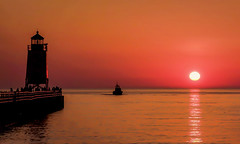 Coming Home (T P Mann Photography) Tags: sun sunset sundown dusk evening lake michigan sea seascape lighthouse pier golden water waters boat summer warm night railing glow reflection sky skies horizon beach silhouettes people