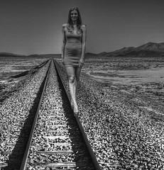 Walking The Line (swong95765) Tags: woman waling tracks rails tyes horizon desolate pretty balance