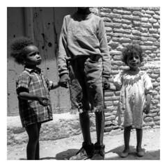 Village Children, Tunisia. (tonywright617) Tags: villagechildren tunisia africa fujica g617 panoramic bw mediumformat 120 ilford hp5 monochrome analogue crop