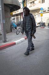 Minority amongst the (former) minority. Tel Aviv, February 2017. (joelschalit) Tags: israel telaviv social men politics ricohgr middleeast streetphotography photojournalism documentary street migrant immigration asylumseeker refugee africa