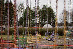 Wild Ride (modestmoze) Tags: ride carousel 2017 500px travel explore colorful lithuania outside outdoors out sky clouds white blue red orange green yellow grass trees chains lines metal wood seats view interesting urban urbanexploring park amusementpark old abandoned unsafe