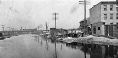 No fancy apartments and condominium towers here. No Hyatt Regency. No bistros, Thai restaurants or Turkish Grills. Just the good old grubby,  smelly Morris Canal looking west to the Central Railroad of NJ Bridge from about Greene Street. Jersey City. 1906 (wavz13) Tags: oldphotographs oldphotos 1906photographs 1906photos oldphotography 1906photography vintagephotography vintagephotographs vintagephotos filmphotos filmphotography historicphotographs historicphotos historicphotography oldbuildings abandonedbuildings railroadphotos railroadphotography railroads vintagerailroads vintagerailroadphotography oldrailroads oldrailroadphotography vintagebuildings 19thcentury vintageconstruction oldhouse oldhouses vintagehouse vintagehouses depressing bleak noir noire dark jerseycityphotographs jerseycityphotos oldjerseycityphotography oldjerseycityphotos oldjerseycity vintagejerseycity vintagejerseycityphotography jerseycityhistory newjerseyphotographs newjerseyphotos oldnewjersey vintagenewjersey newjerseyhistory urbanphotography urbanphotos railroadbridges oldrailroadbridges vintagerailroadbridges antiquerailroads industrialjerseycity oldtelegraphpoles vintagetelegraphpoles industry industrial urbandecay urbanwasteland urban urbanexploration abandoned vintageindustry oldindustry vintageindustrial oldindustrial centralrailroadofnewjersey jerseycentral crrnj