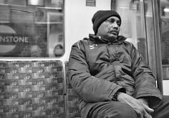 Stoned ? No, Just Tired (tcees) Tags: centralline tubetrain leytonstone train tube lt x100 fujifilm seat man window sign blackandwhite monochrome uk earthnight