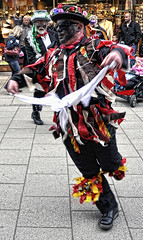 East Suffolk Morris Men, Bury St. Edmunds Christmas Fayre (Martin Carey) Tags: flowers hat sunglasses bells nikon bowlerhat burystedmunds morrisdancer blackshoes blacktrousers morrisman redhandkerchief eastsuffolkmorrismen nikond90 whitehandkerchief november282010