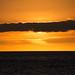 obscured by clouds (nosha) Tags: ocean sunset sea sky orange usa cloud seascape beautiful beauty yellow hawaii horizon