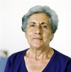 Portrait of a senior woman (Nasos Zovoilis) Tags: life old grandma portrait people woman brown white color film senior beauty face look proud lady female rural scarf hair greek happy person clothing women europe mediterranean european village looking dress adult grandmother folk expression background character postcard teeth traditional country gray mother mani pride hasselblad greece human mature elderly age experience elder laugh older aged redneck balkans wisdom tradition middle granny widow retired suffering aging tough wrinkles wrinkle isolated textured peasant villager caucasian fuji400h